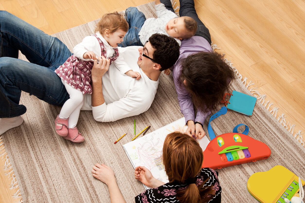 Family Playing On Rug
