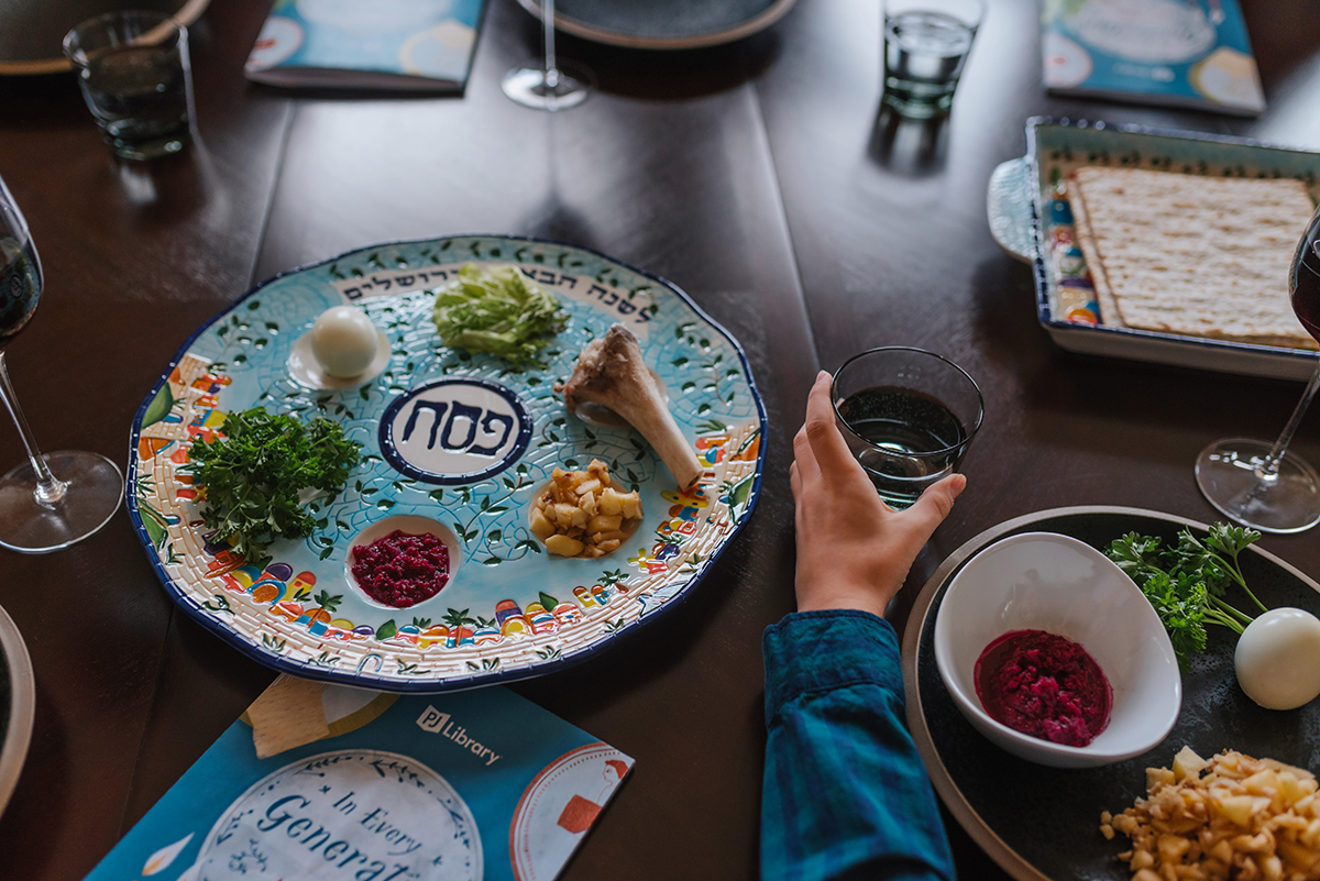 Seder plate on table with place settings