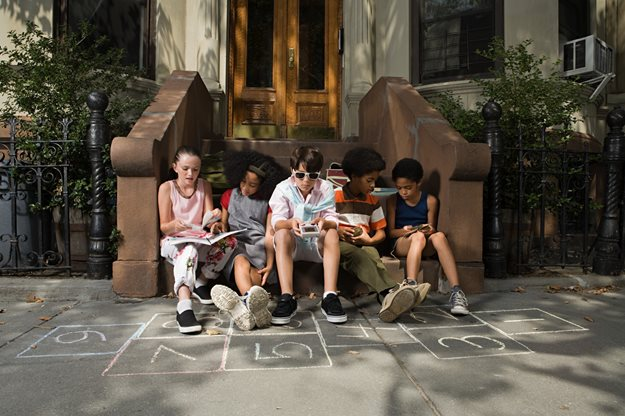 Kids sitting on New York City stoop