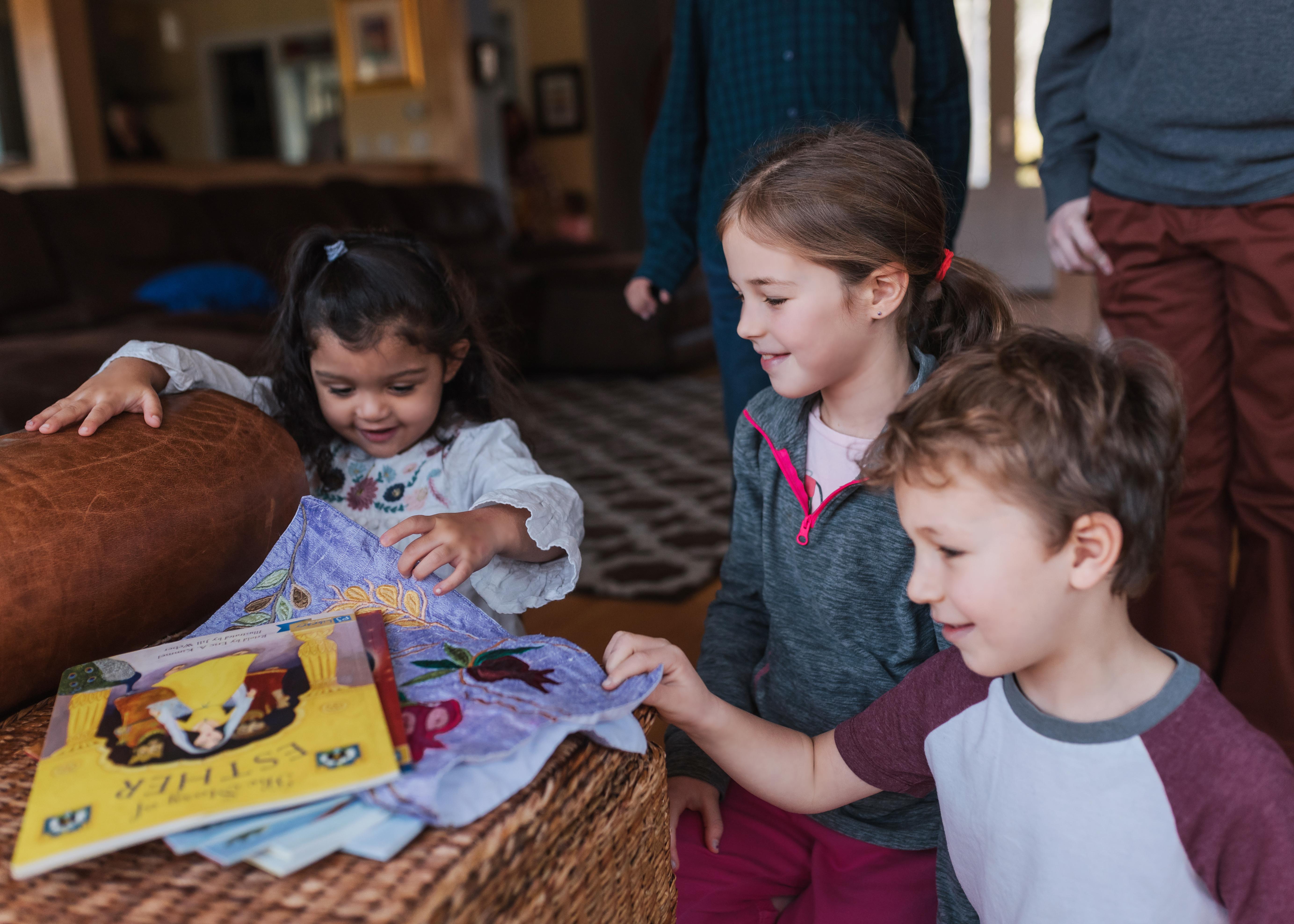 Three children finding the afikomen
