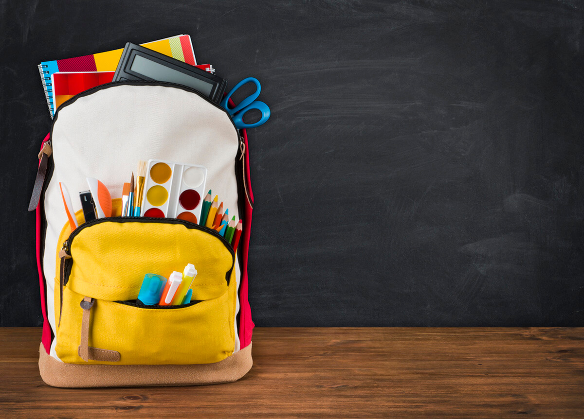 Child's backpack full of school supplies