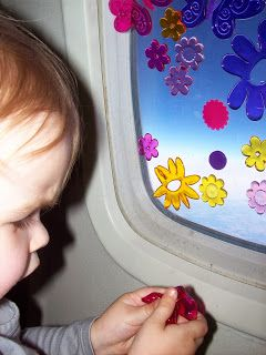 Toddler playing with window clings
