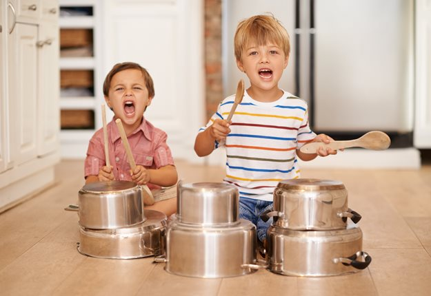 Boys playing with pots and pans